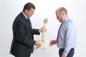 Chiropractors Bethel Park PA Jerry and Gerald Marcinak holding spine model